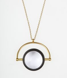 Magnifier pendant, sterling silver, gold and black rhodium plated, rock crystal  Amy Keeper jewellery designer and maker