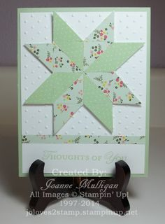 hand crafted quilt card ... punched squares used to create a pieced star ... luv the soft colors  .. polka dots and dots embossing folder ... soft greens ... Stampin' Up!