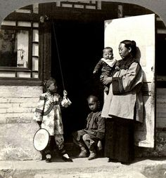 WAITING FOR DAD TO COME HOME in OLD CHINA  Photographed by British Photographer HERBERT PONTING in 1902 for the stereoview publishing company of C.H. GRAVES.