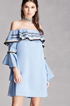 A woven shift dress featuring an off-the-shoulder design, a pom-pom and crochet trim, a flounce layer, short trumpet sleeves, and a concealed side zipper. This is an independent brand and not a Forever 21 branded item.