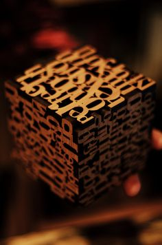 Wood block with typographic print