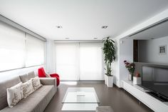 Interior, Home Design Architecture Also White Interior Living Room Idea Also Cream Sectional Sofa With Red Armchair And Modern Entertainment Center Also Glass Coffee Table: Bring Clean And Elegant Feels With White Home Design Interiors