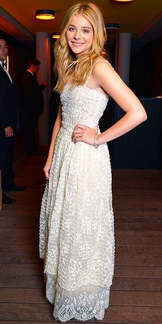 On the Red Carpet at Cannes | CHLOË GRACE MORETZ | Another event, another Chanel ensemble for Chloë. After looking like a Venetian gondolier and a feathered friend, the actress selects a white lace maxi for a dinner party hosted by the French fashion house.
