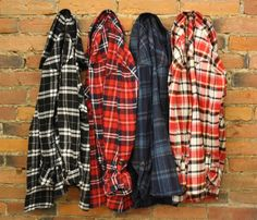 One of our must-haves for fall, a classic flannel plaid shirt. This piece is soft and comfortable, perfect for layering under chunky knits and leather jackets. Roll up the  button tab sleeves for a laid-back look or wear down.  COLORS Red/NavyRed/TaupeNavy/ TealBlack/ White SIZESSmall 0-4Medium 4-6Large 8-10(size up for a oversized look) Model is wearing a small.