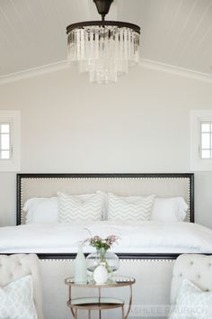 Beach House Master Bedroom with Odeon Chandelier via Becki Owens