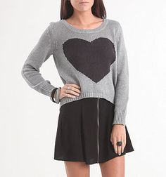 TREND ALERT: Oversized sweather with heart.  ORIGIN: Wildfox  SIMILAR: Pacsun, Forever21.  -hah