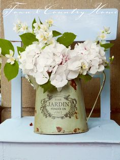 Place hydrangeas or other flowers into a plastic cup or glass and place inside a vintage pail or vessel for a rustic display  ~TOWN COUNTRY HOME #rusticflowers #floralvignette #shabbychic