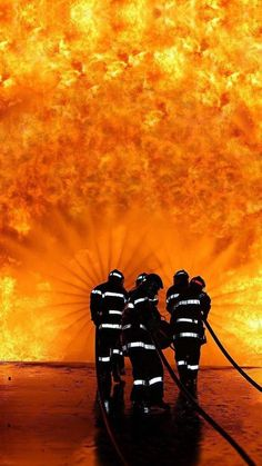 These firefighters against a wall of fire