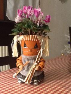 Personnage en pot de fleur