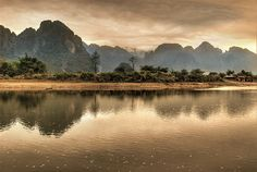 Vang Vieng, Laos. This was the most beautiful place I went in Laos, the mountains are breathtaking. It didn't seem real waking up to this view! #backpacking