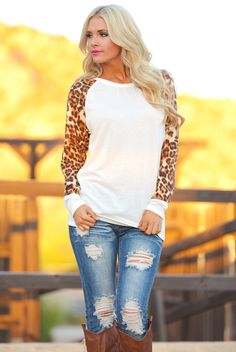 This is so perfectly my style...casual but unique top, distressed jeans, and boots. Closet Candy Boutique