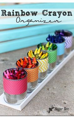 Great way to organize crayons and recycle used cans!  Use different colored scrapbook paper on the cans for the different colors!