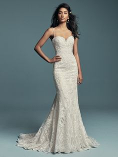 Shop the flirtatious Maggie Sottero Gwendolyn Lace Mermaid Bridal Gown today! Beaded lace motifs cascade over tulle in this sexy fit-and-flare wedding dress. Wedding Dress Boutiques, Designer Wedding Dresses, Bridal Dresses, Bridesmaid Dresses, Maggie Sottero Wedding Dresses, Wedding Gowns, Lace Wedding, Dream Wedding, Church Wedding