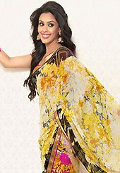 The most radiant carnival of style and beauty. This yellow and pink faux georgette saree is nicely designed with floral, abstract print and graceful patch border. Saree gives you a singular and dissimilar look. Matching pink blouse is available. Slight color variations are possible due to differing screen and photograph resolution.