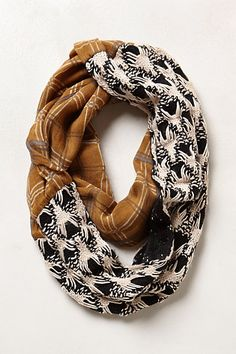 Whitetail Lodge Infinity Scarf - $48 at Anthropologie.  There are some lovely combination scarves here that could be very inspiring for a seamstress...
