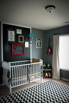 How could you not love a black and white chevron rug? I love the chalkboard area behind the crib. I wld put it behind the changing table though. Cld use for a item list of things to get for baby @ store. Also the room is where he cld grow into it :)