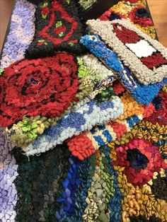 Small rug hooking kits by Deanne Fitzpatrick. Colorful floral, summer and scenery patterns.