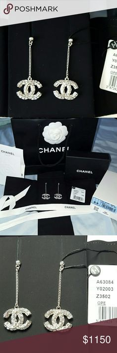 Authentic Chanel crystal dangle large earrings Brand new authentic 2016 Chanel crystal dangle large cc earrings.  This pair earrings are extremely sparkly. Very very stunning! Comes with everything,  tag,  velvet duster, box, ribbon,  camellia flower, shopping bag, gift receipt from Chanel. This earrings don't have the typical stamp like the earing studs,  I guess there is no where to have a stamp on these earrings.  Top part shows CC logo on the earrings. This earrings is extremely hard to…