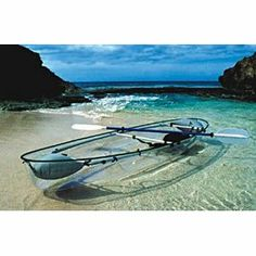 taking a clear kayak somewhere tropical