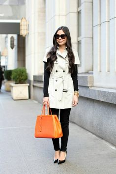 Love the pop of orange against the crisp white and black trench