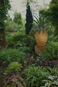 Agave in the shade  Garden art urn by KarlGercens.com, via Flickr
