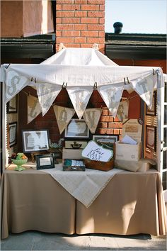 """tented welcome table pre ceremony. Put crates on filled with....  Paper fans for when it hots up Packets of tissues for happy tears Pots of bubbles instead of confetti """"Amuse-me"""" packs for the kids"""