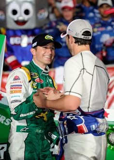 2012-05-27    CONCORD, NC - MAY 27: Jimmie Johnson (R), driver of the #48 Lowe's Patriotic Chevrolet, congratulates Kasey Kahne (L), driver of the #5 Quaker State Chevrolet, in Victory Lane after winning the NASCAR Sprint Cup Series Coca-Cola 600 at Charlotte Motor Speedway on May 27, 2012 in Concord, North Carolina. (Photo by John Harrelson/Getty Images for NASCAR)