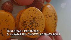Macarontoren van frambozen en sinaasappelchocolade macarons