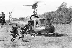 1966 Australian soldiers with a Huey helicopter, Vietnam