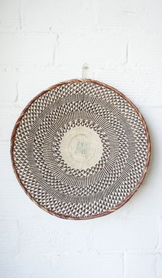 South African woven disc basket as a wall decoration. Home Interior, Interior Decorating, Interior Design, African Design, African Art, Deco Ethnic Chic, Rattan Lampe, Baby Furniture Sets, Basket Weaving