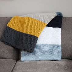 Easy knit blanket, knit all rows, 2 strands of Worsted weight/ #4 yarn on larger needles then required for a #4 weight yarn