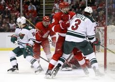 Detroit Red Wings center Riley Sheahan (15) fights for position against Minnesota Wild center Charlie Coyle (3) during the third period at Joe Louis Arena. The Red Wings won 3-2.  #9223442