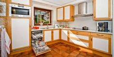 Our exclusive large apartment with 3 bedrooms, 2 bathroom for up to 8 persons with 135 more than double the size than most apartments in the Seefeld Dutch Kitchen, Apartments, Netherlands, Kitchens, Kitchen Cabinets, Bathroom, Table, Furniture, Home Decor