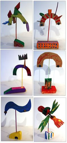 cardboard balancing sculptures made with magnets