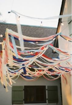 """Ribbons and lights used to make a """"pergola"""" outside"""