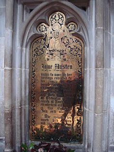 A later memorial to Jane Austen on the wall by the grave in Winchester Cathedral.