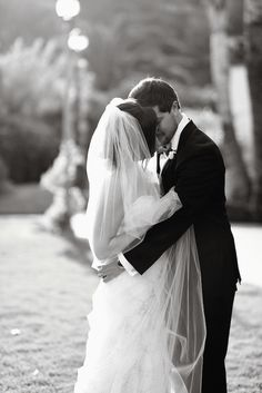 Romantic Couple Embracing Each Other | Photography: Laurie Bailey Photography. Read More:  http://www.insideweddings.com/weddings/classic-california-wedding-with-outdoor-ceremony-indoor-reception/853/