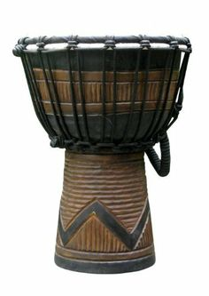 """Forest Wind Djembe: 11""""-12"""" Tall x 7""""-8"""" Head by Mother Rhythm Drums. $36.00. Hand-carved peace sign design djembe drum. Made of one-piece mahogany and goat skin. Snappy sound and perfect for kids or an excellent light weight travel drum for adults. Makes a great contribution to the energy of the """"all age inclusive"""" drumming circle. Also makes an excellent gift idea."""