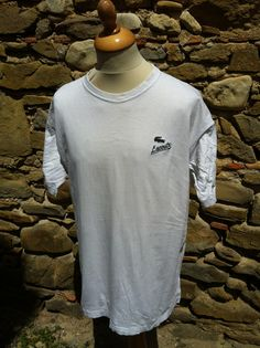Pick up this clean vintage Izod, lacoste Tee. Italic script underneath the bolder than usual Lacoste croc logo No rips or tears. Single mark to the side chest (