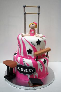 Gymnastics cake with gymnast, bars, beam and vault - Frosted Bake Shop.