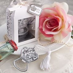 Looking for an elegant wedding favor?  This crown bottle opener will make a gorgeous gift for your guests.  Beautifully presented in a white scroll work gift box.  Only $2.04 each with a bulk purchase of 50.  We're always happy to give a price quote if you need a different quantity!
