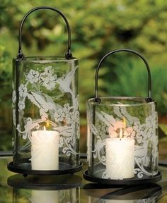 lovely candle lanterns against a green backdrop Candle Lamp, Candle Lanterns, Candle Sconces, Lace Candles, Glass Candle, Chandeliers, Candle In The Wind, Oil Lamps, Fairy Lights