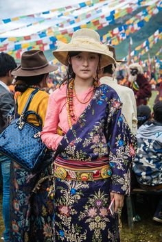 Young Tibetan woman. This is the off the shoulder look I've been trying to do!!!!!