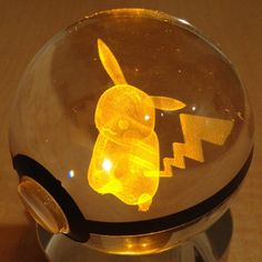 Light up your room the way a true Pokemon Master would with a truly unique piece of art. LED light shines through the crystal Pokeball - illuminating the 3D laser-sketched Pokemon trapped inside. Guaranteed to impress any Pokemon fan.