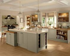 KITCHEN: I believe this is a Howden's kitchen; like the look of it. Central island in a different shade. Look at later.