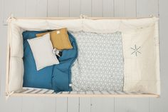 Mix pattern and plain with Camomile london's reversable cot quilts in our dash star print.