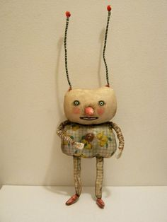 little monster bug art doll ... is 12 inches tall..... On the back of the art doll .... a loop so you could hang on the wall ..... or prop up on a