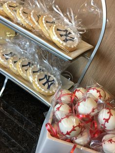 Baseball Theme Baby Shower   NY Yankee cookies and baseball cake pops were the perfect dessert option for this shower.