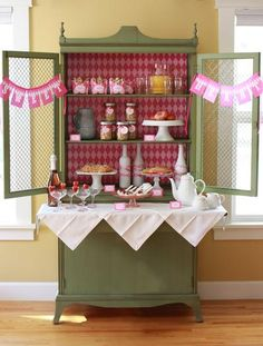 Love the use of the armoir for party decor and refreshments.