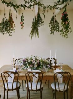 Rustic tablescape with hanging herbs + greens overhead